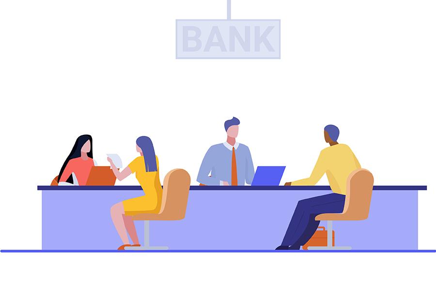 متصدیان امور بانکی در حال پاسخگویی به مشتریان
